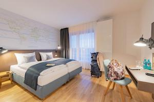 A bed or beds in a room at JUFA Hotel Hamburg HafenCity