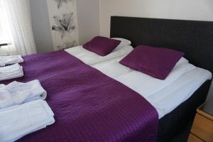 Säng eller sängar i ett rum på Rum För Resande