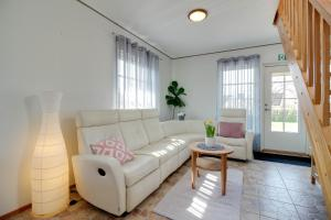 A seating area at Kasekese Holiday Home