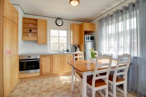 A kitchen or kitchenette at Kasekese Holiday Home