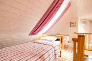 A bed or beds in a room at Kasekese Holiday Home