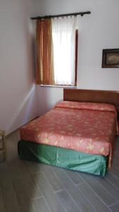 A bed or beds in a room at La Sirenetta Park Hotel