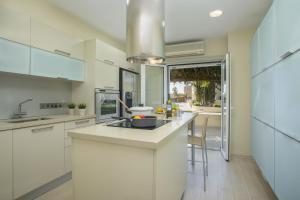 A kitchen or kitchenette at Sirina Bay Villa