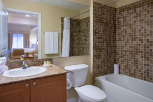 A bathroom at The Point Hotel & Suites Universal