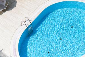 The swimming pool at or close to Hotel Imperial ***S