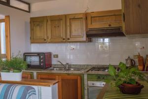 Cucina o angolo cottura di Appartamento a 10 minuti a piedi dal mare