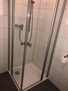 Ein Badezimmer in der Unterkunft Pension Osthoff