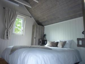 A bed or beds in a room at Domaine De Siane