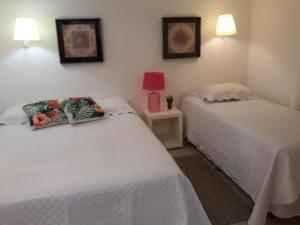 A bed or beds in a room at Taiba Beach Resort