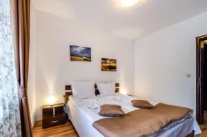 A bed or beds in a room at I love Varna Apartments