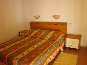 A bed or beds in a room at Villas Oleandri