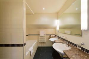 Ein Badezimmer in der Unterkunft Hotel Bären Langenthal