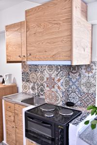 A kitchen or kitchenette at Artemis Hotel Apartments