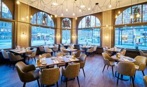Een restaurant of ander eetgelegenheid bij Amrâth Grand Hotel de l'Empereur