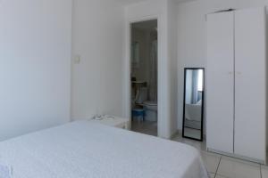 Cama ou camas em um quarto em Apartamento Temporada Pajuçara