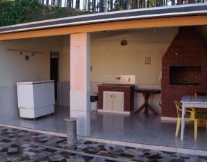 A cozinha ou kitchenette de Pousada Recanto da Vovó
