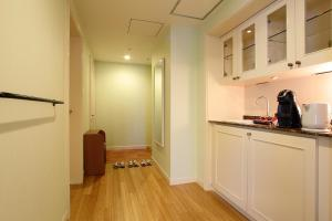 A kitchen or kitchenette at Namba Oriental Hotel