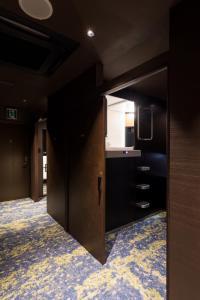 京都河原町格蘭希特膠囊旅館電視和/或娛樂中心