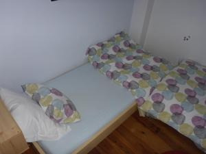 A bed or beds in a room at Gite Sent Martin