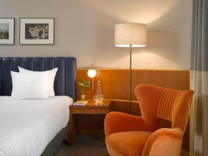 A bed or beds in a room at K+K Hôtel Cayré Saint Germain des Prés