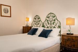 Letto o letti in una camera di Bellezza Suites
