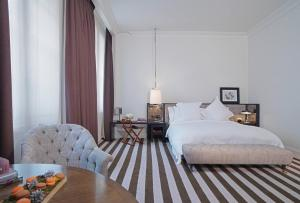 A bed or beds in a room at Rosewood London