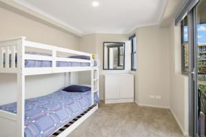 A bunk bed or bunk beds in a room at Flightdeck 301 5-7 Clarence Street
