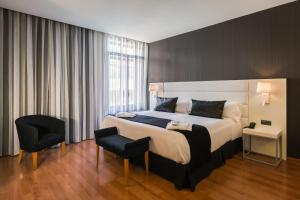 A bed or beds in a room at Catalonia Plaza Mayor Salamanca