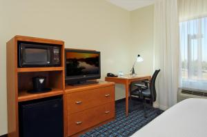 A television and/or entertainment center at Fairfield Inn & Suites Fresno Clovis