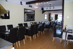 A restaurant or other place to eat at Brincliffe Hotel