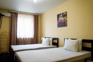 A bed or beds in a room at Fedorov ApartHotel Barnaul