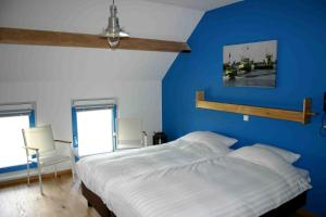 Een bed of bedden in een kamer bij Herberg Tiengemeten