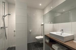 Een badkamer bij Hotel Restaurant in den Hoof