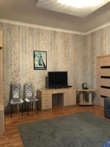 Телевизор и/или развлекательный центр в Гостевой Дом Лили