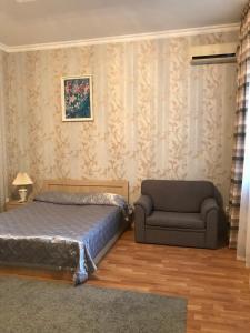 Кровать или кровати в номере Гостевой Дом Лили