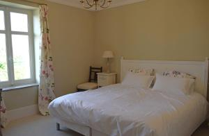 A bed or beds in a room at L'Ancien Domaine 6 personnes