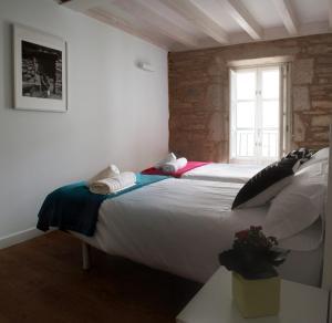 Cama o camas de una habitación en On the Way - En el Camino