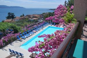 A view of the pool at Hotel Palazzina or nearby