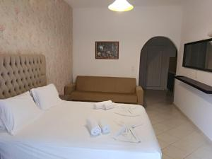 Ένα ή περισσότερα κρεβάτια σε δωμάτιο στο Villa Dorita Luxury Apartments