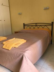 Ένα ή περισσότερα κρεβάτια σε δωμάτιο στο Remezzo Apartments