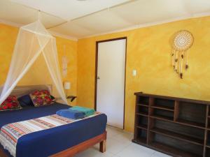 Cama o camas de una habitación en Casa Abanico Tulum