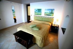 A bed or beds in a room at L'Eco dell'800
