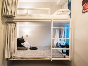 A bunk bed or bunk beds in a room at Chamberlain Boutique House - Silom