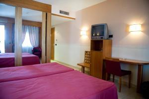 Cama o camas de una habitación en Hotel La Maruxiña