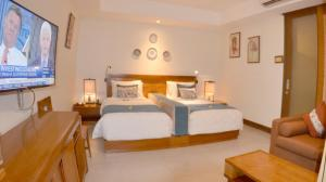 A bed or beds in a room at Rama Garden Hotel Bali