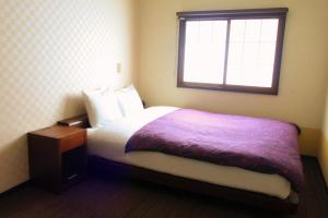 A bed or beds in a room at K's House Takayama [1st K's Hostel]