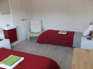 A bed or beds in a room at O Cabalo Verde