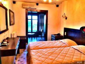 Легло или легла в стая в Hotel Taxiarches