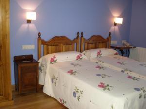 Cama o camas de una habitación en La Posada de Cucayo