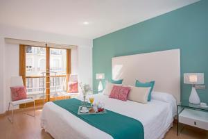 Cama o camas de una habitación en Singular Stays Plaza de la Reina